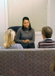 Photo of a couple meeting with a counselor