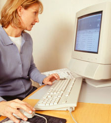 Photo of a woman working at a computer