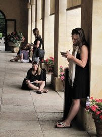 Jessica Conrardy (foreground), Melissa Ross and Allison Pfeifer sketch at Villa Emo.