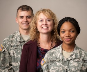 Briana Nelson Goff, professor and director of the Institute for the Health of Military Families, works with students such as Gardner and Smith, both majors in family studies and human services.