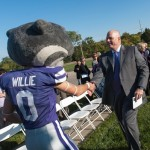 Willie greets Carl Ice at the building dedication.
