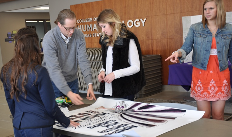 Apparel, textiles, and interior design students and faculty set up activities and exhibits for Open House Saturday.