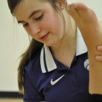 Athletic training student Karla Schwalenberg works with a dance student