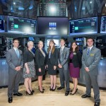 Mariah Bausch, center, joins other scholarship winners on the floor of the New York Stock Exchange.
