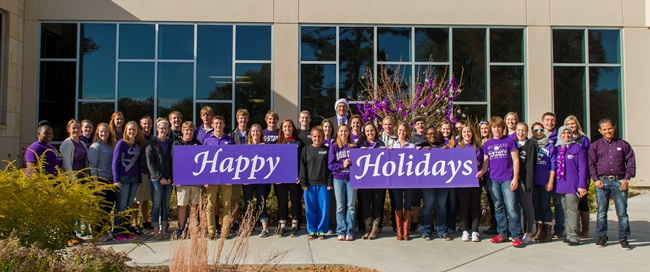 A few of the splendid students in the College of Human Ecology with Dean John Buckwalter (in hat).