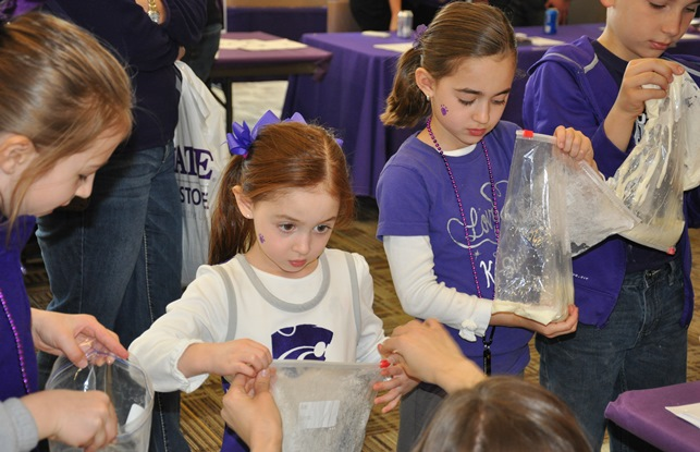 Young Wildcat fans get a chemistry lesson from family and consumer sciences students at Open House 2014. Above, balloons mark the spot of the Center on Aging exhibit in 2014.