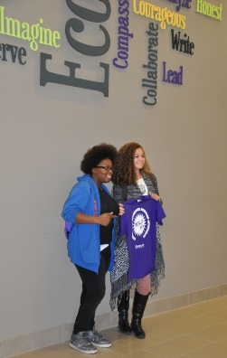 High school students at the 2014 Wild about FCS pose with their new t-shirts (purple of course) under the Justin Hall word cloud.